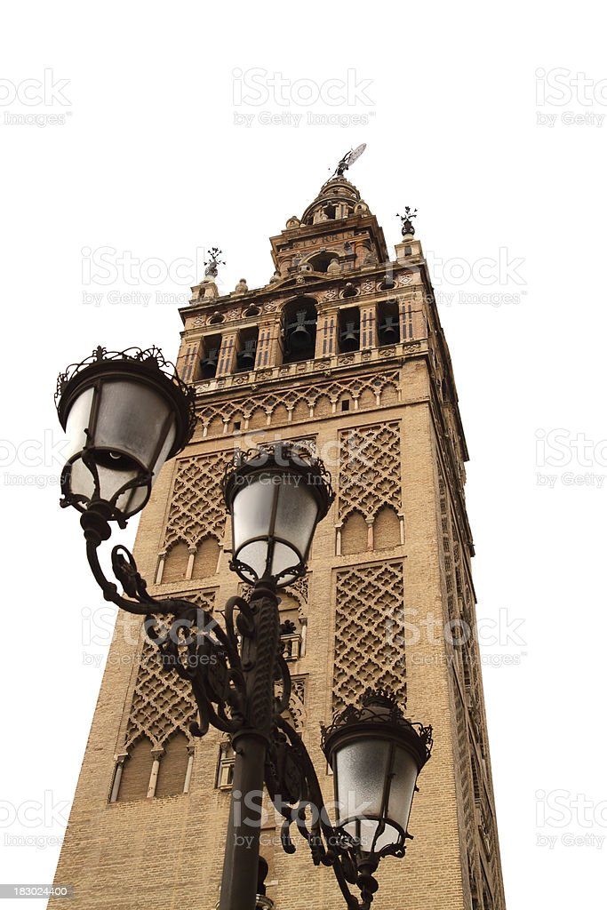 Seville (Sevilla). The Giralda Tower and street lamps royalty-free stock photo