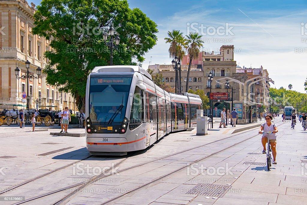 Seville trams (light rail) blend with historic city centre stock photo