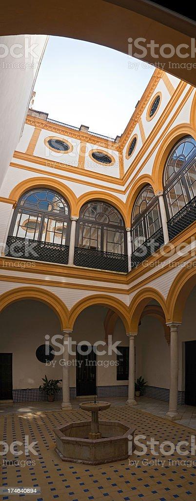 Seville tranquil moorish courtyard vertical stock photo