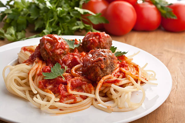 seving of spaghetti with meatballs stock photo