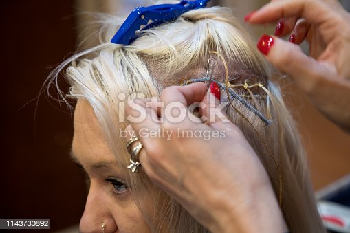 istock Sew in hair extension being attached 1143730892