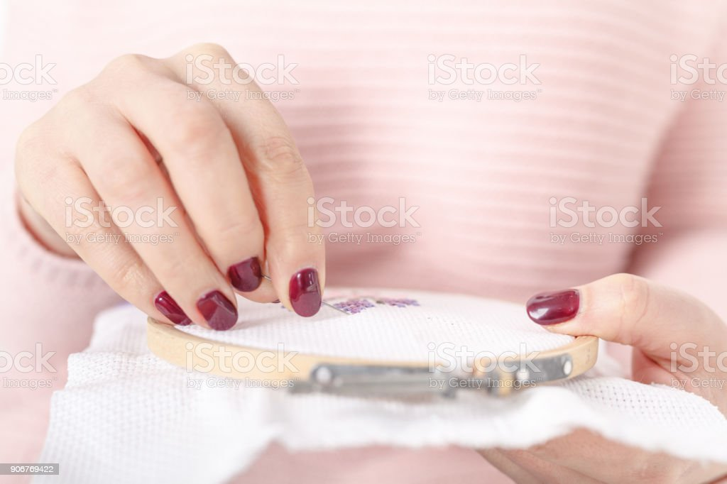 sew or embroider using cross-stitche stock photo