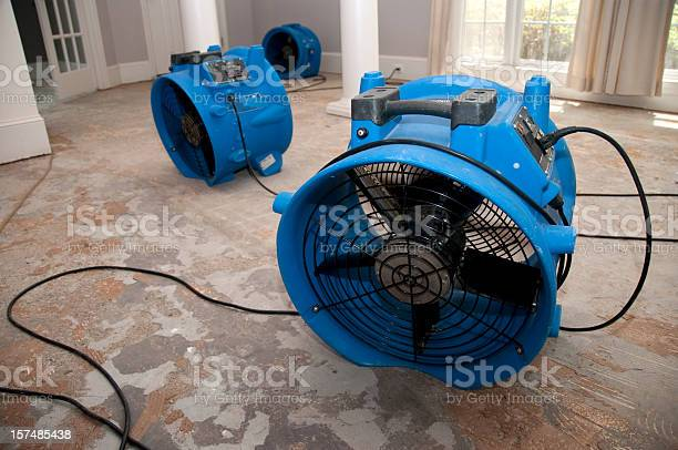 This is the sewage water damage recovery process in a residential home. The flooring is ripped off, and the rooms are sprayed with biowash. Industrial fans and dehumidifiers is placed in the room for the drying and restoration process. The process will last 3 days.