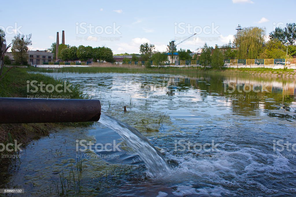 sewage from the sewer pollute a lake, river stock photo
