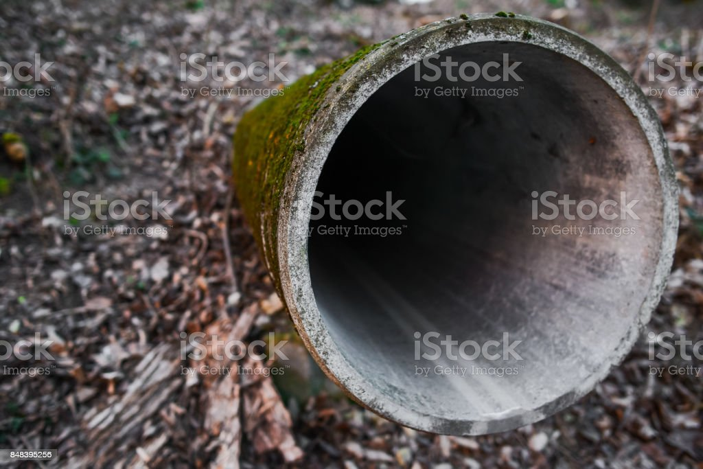 sewage pipe acts on the ground stock photo