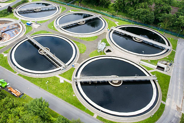 Sewage treatment plant - aerial view Sewage treatment plant - aerial view sewage stock pictures, royalty-free photos & images