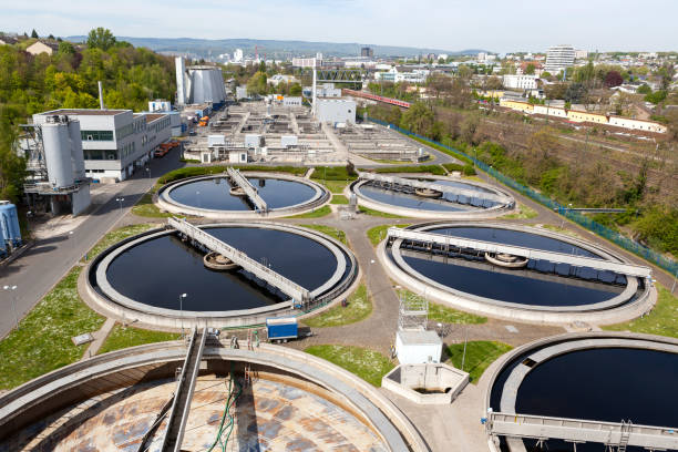 Sewage treatment plant - high-angle view Sewage treatment plant - high-angle view sewage treatment plant stock pictures, royalty-free photos & images