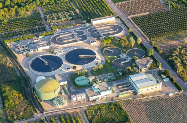 Sewage treatment plant Aerial view of a sewage treatment plant in Valencia, Spain. sewage treatment plant stock pictures, royalty-free photos & images