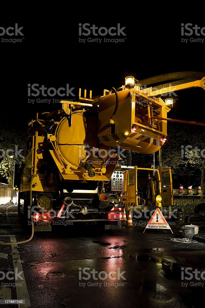 Sewage truck - working at the water system stock photo