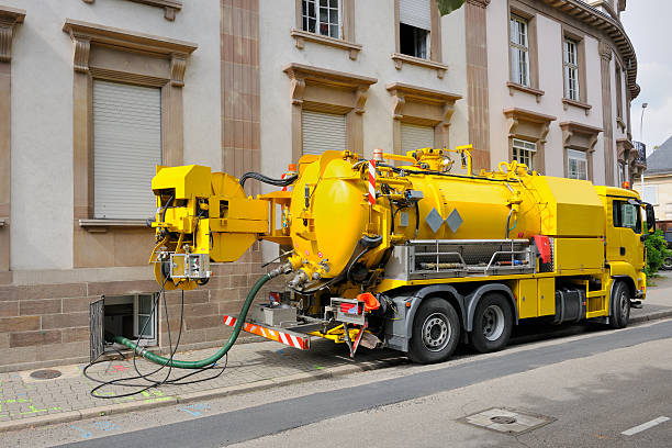 sewage truck working in urban city environment - poisonous stock pictures, royalty-free photos & images