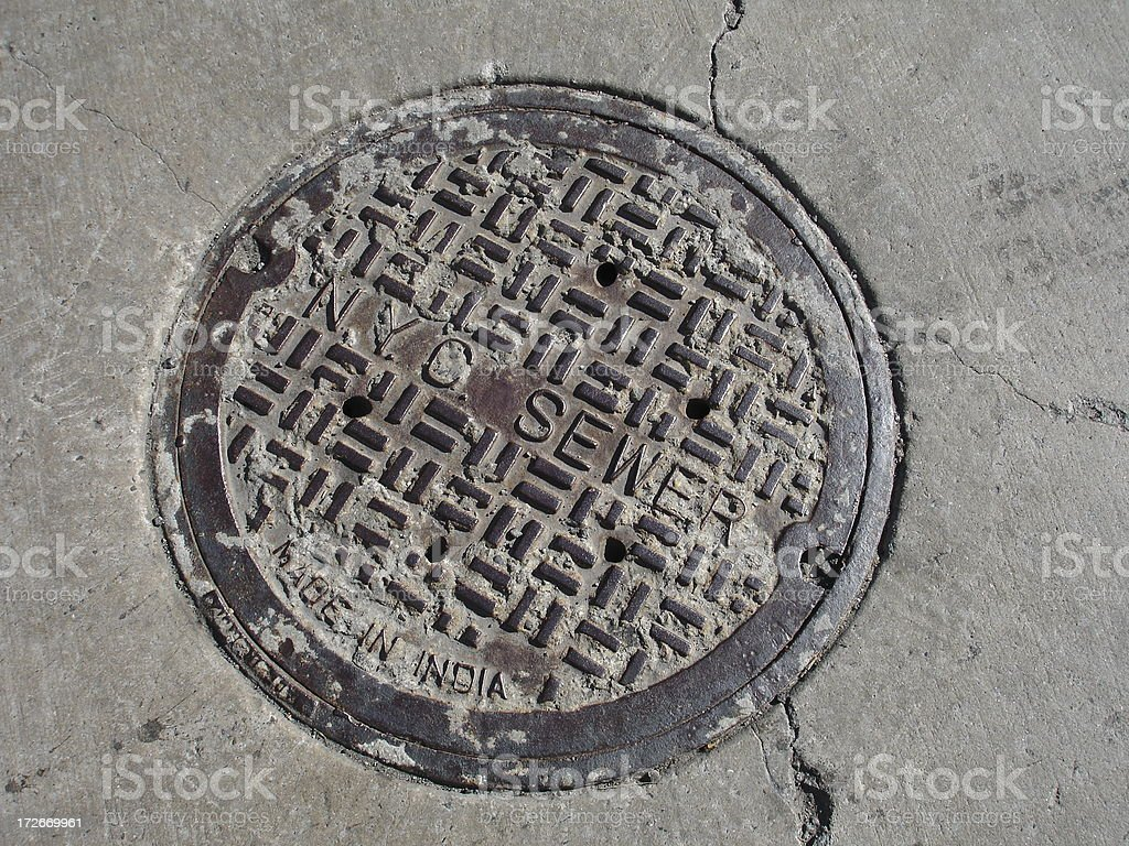 NYC Sewer Cap stock photo