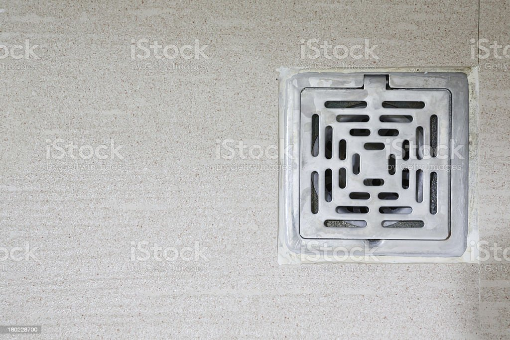 sewer grate drain water stock photo
