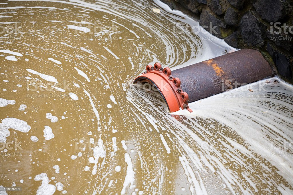 Sewer Pipe In Stagnant Water stock photo