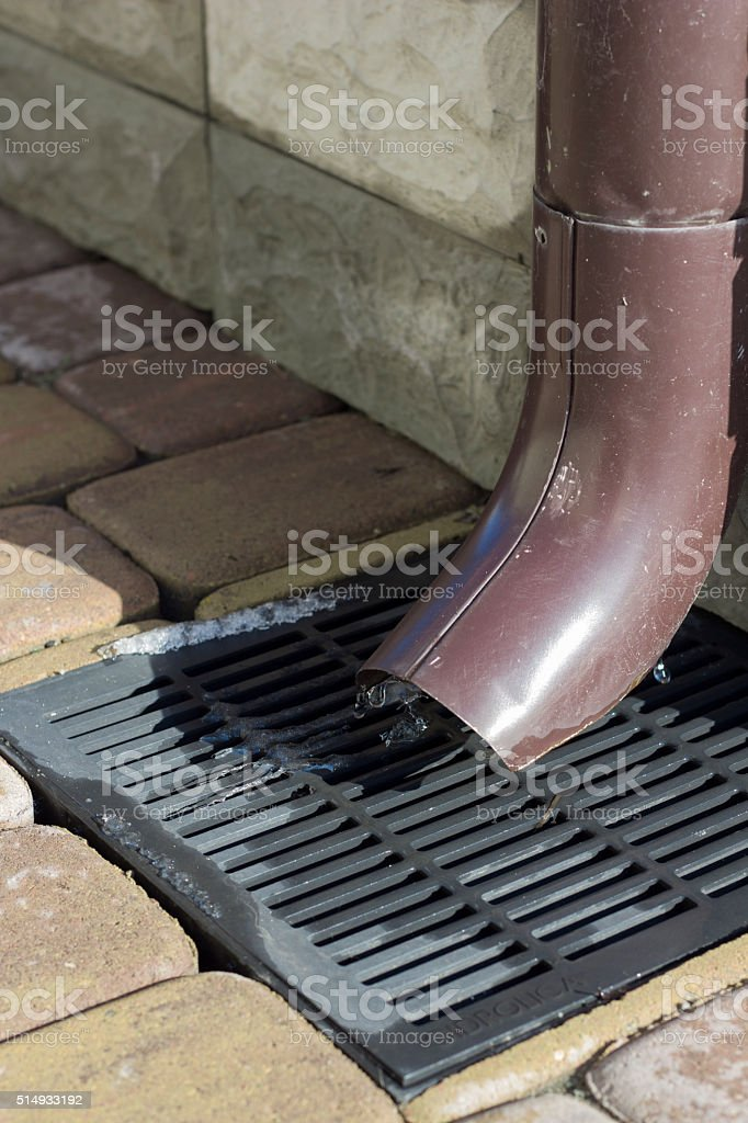 Sewer Rainwater and sewer grate for drainage system stock photo