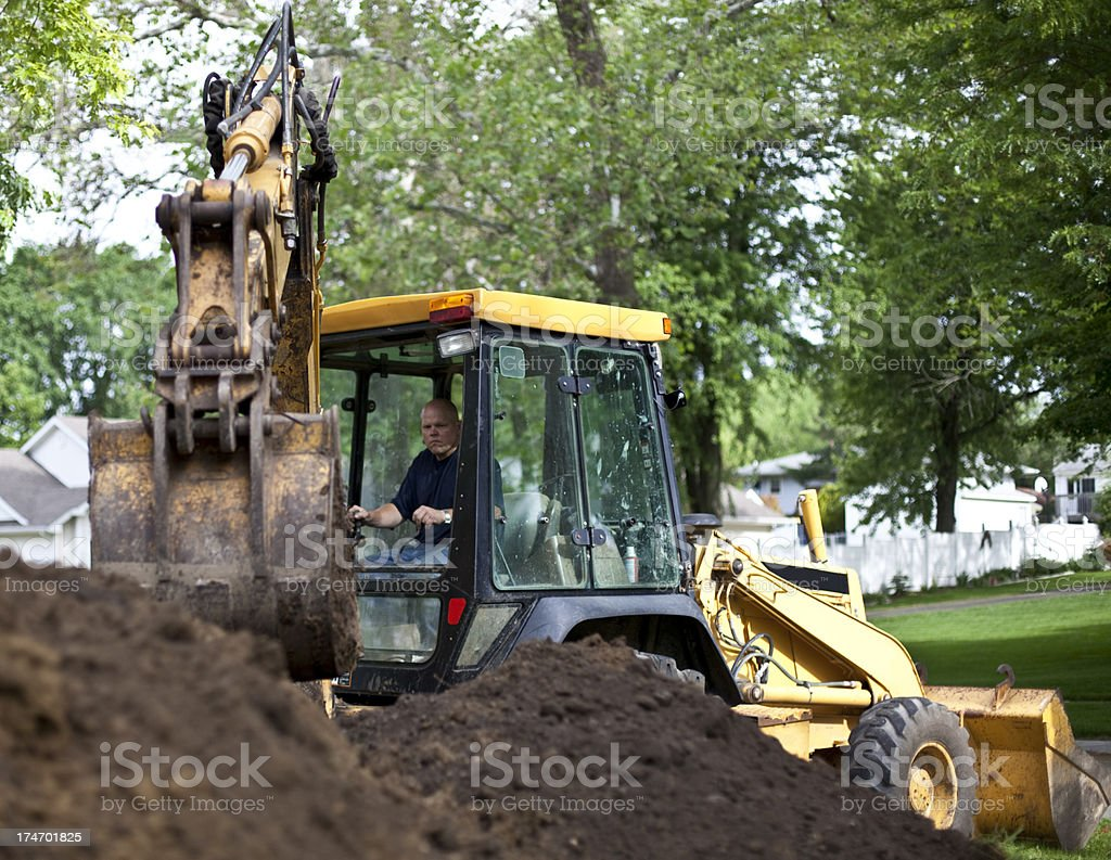 Sewer repair with backhoe royalty-free stock photo