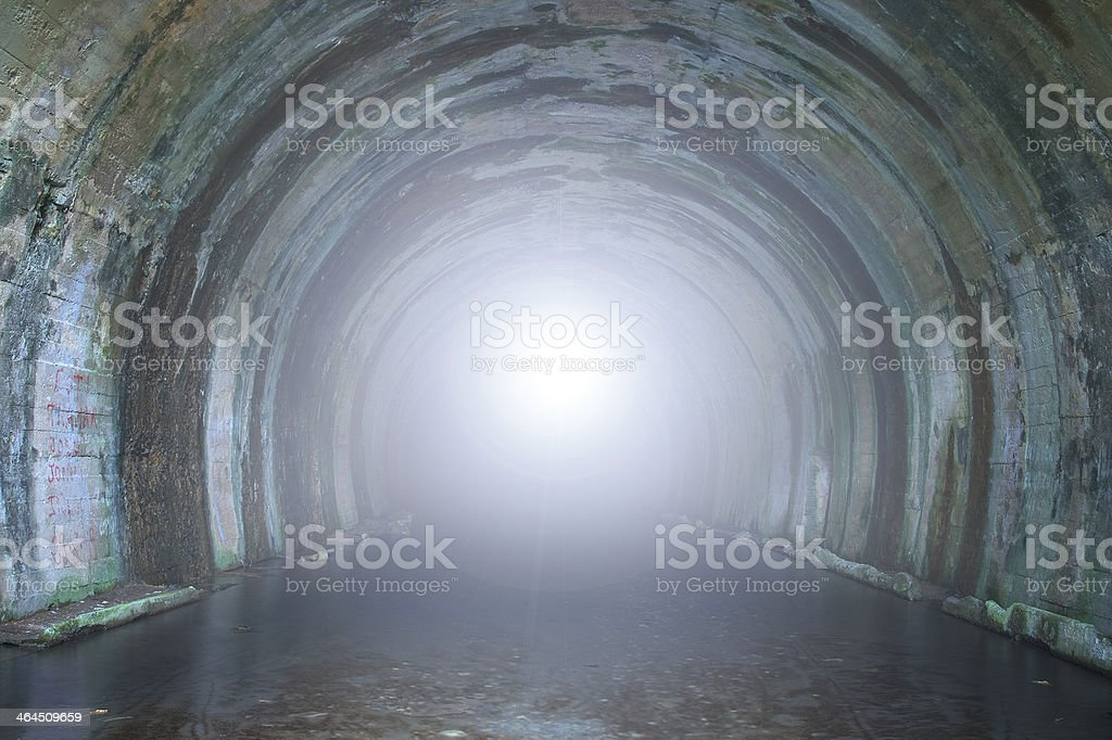 Sewer tunnel with bright light stock photo