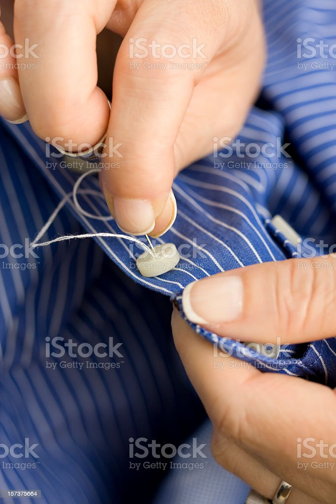 sewing a button royalty-free stock photo