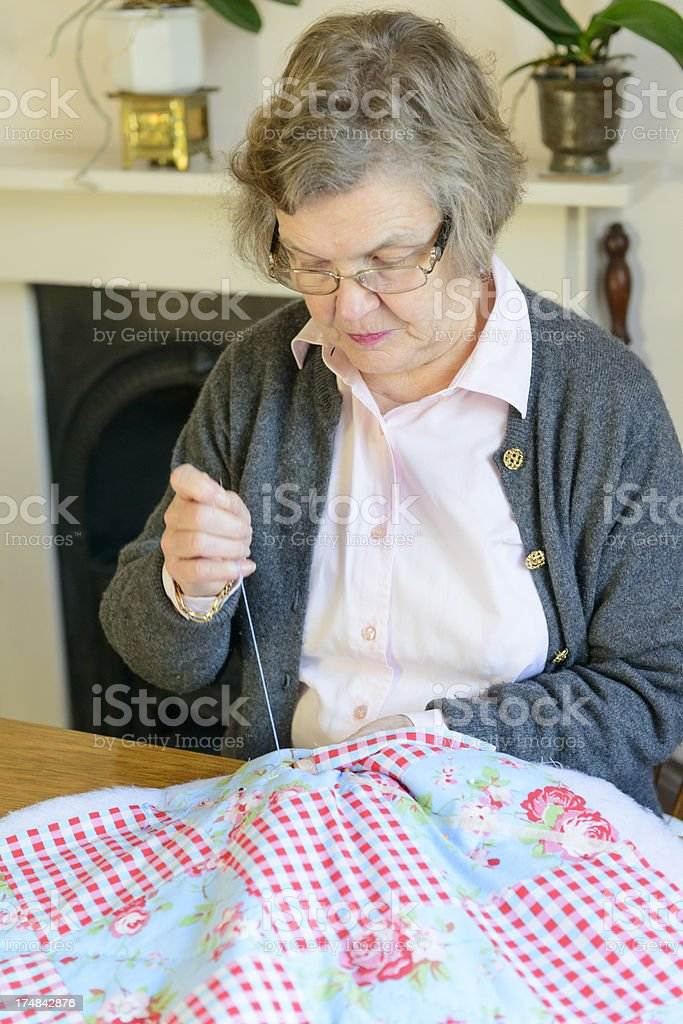Sewing a patchwork quilt royalty-free stock photo