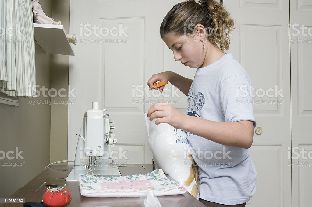 sewing a pillow 1 stock photo