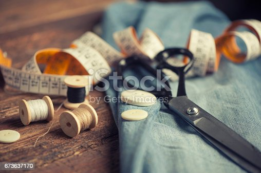 istock Sewing accessories on wooden 673637170