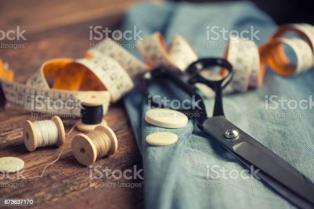 Sewing accessories on wooden picture id673637170?b=1&k=6&m=673637170&s=612x612&h=kkxkzjdqsparwbn 3o6re2acm1vcrmqoajmc 5izipw=