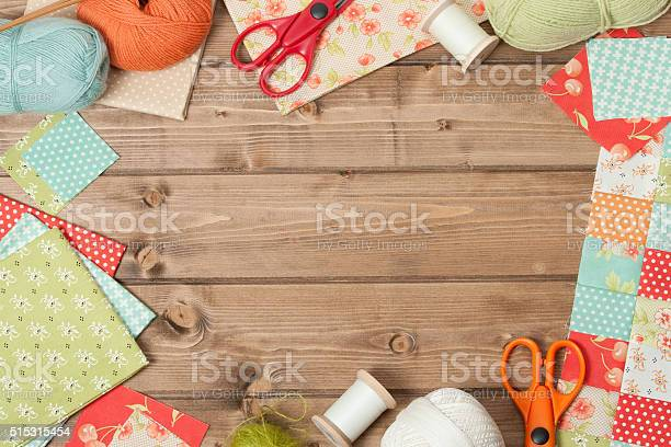Sewing And Knitting Accessories. Fabric, Yarn Balls On Wooden Table. Copy Space