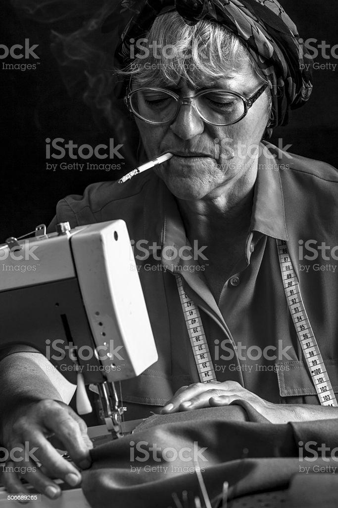 Sewing and smoking royalty-free stock photo