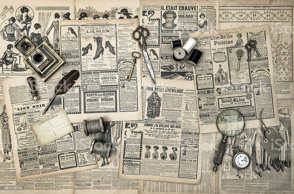 sewing and writing tools, vintage fashion magazine stock photo