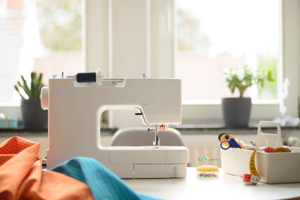 Sewing at home stock photo