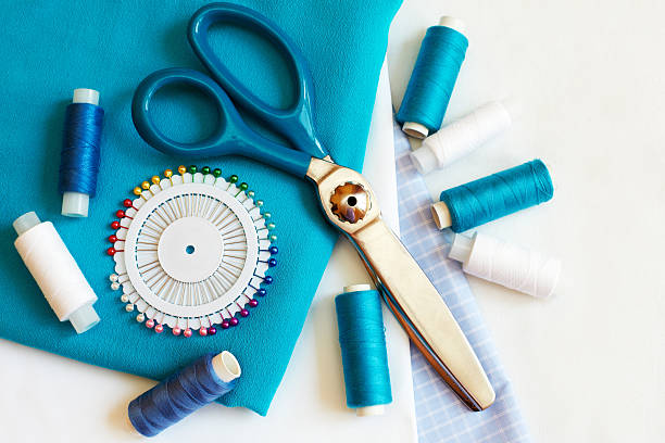Sewing background with color threads, meter, pins and scissors stock photo