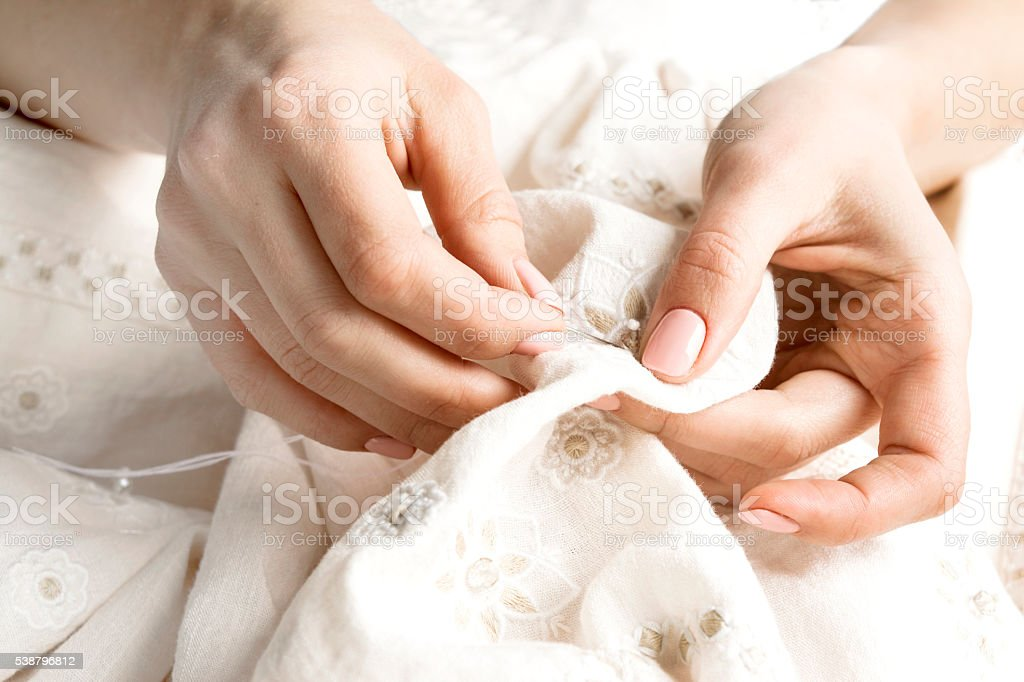 sewing clothes by hand stock photo