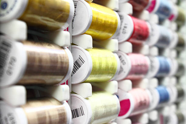 sewing cotton bobbins - embroidery machine stock pictures, royalty-free photos & images