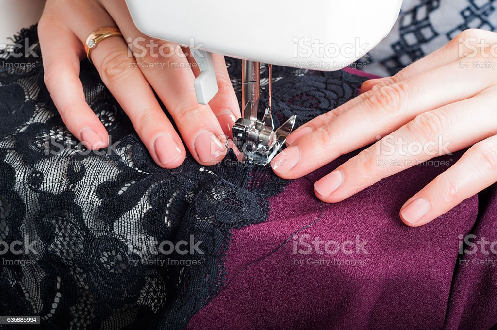 Sewing dress with machine stock photo