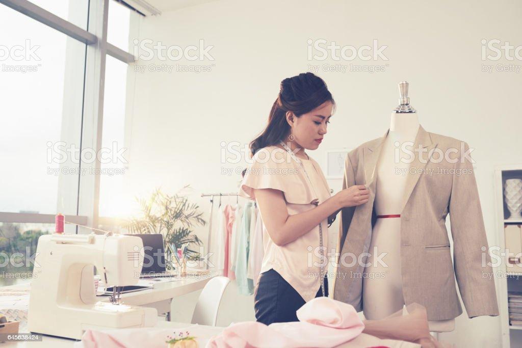 Sewing female jacket stock photo