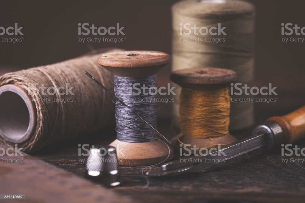 Sewing instruments, threads, needles in vintaae style stock photo