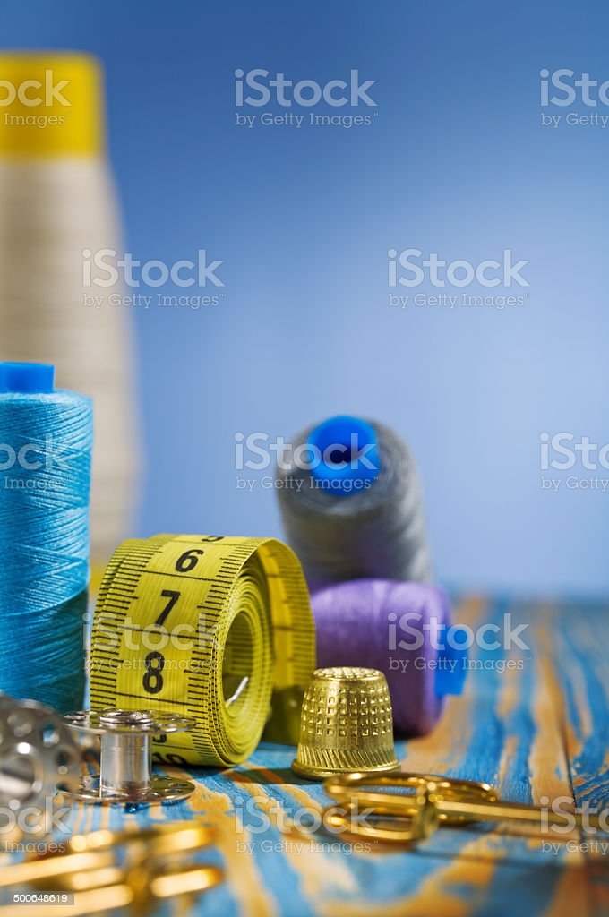 sewing items on blue background stock photo