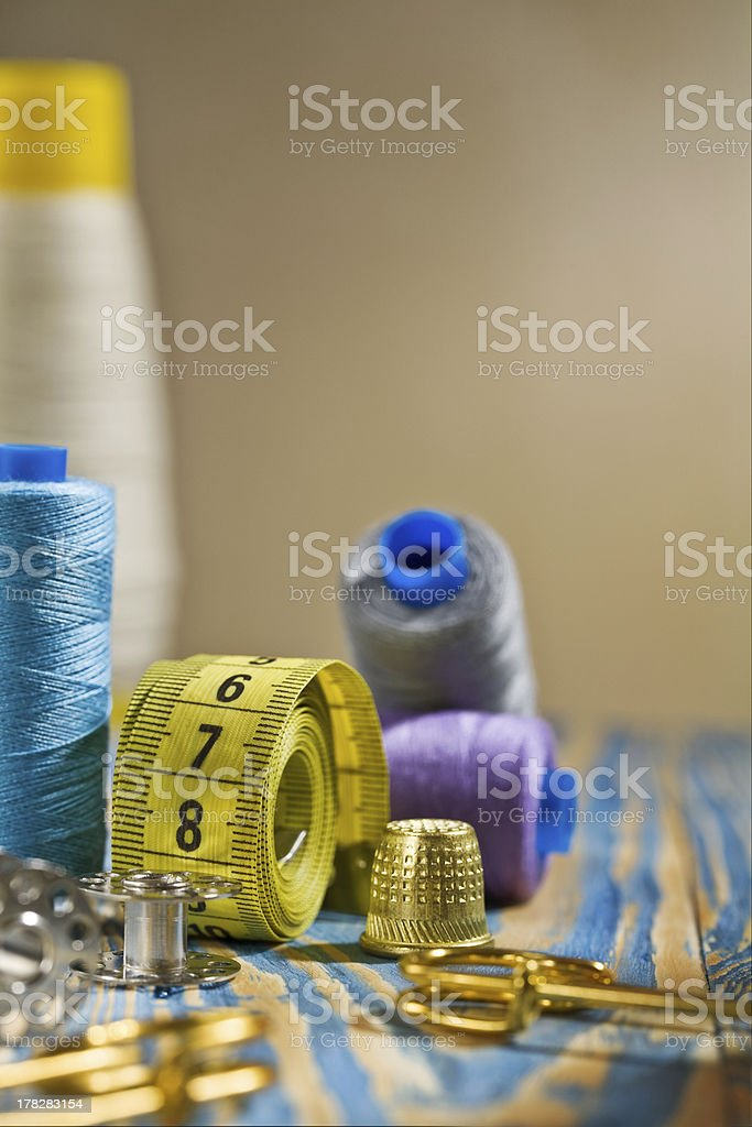 sewing items on the old wooden table stock photo