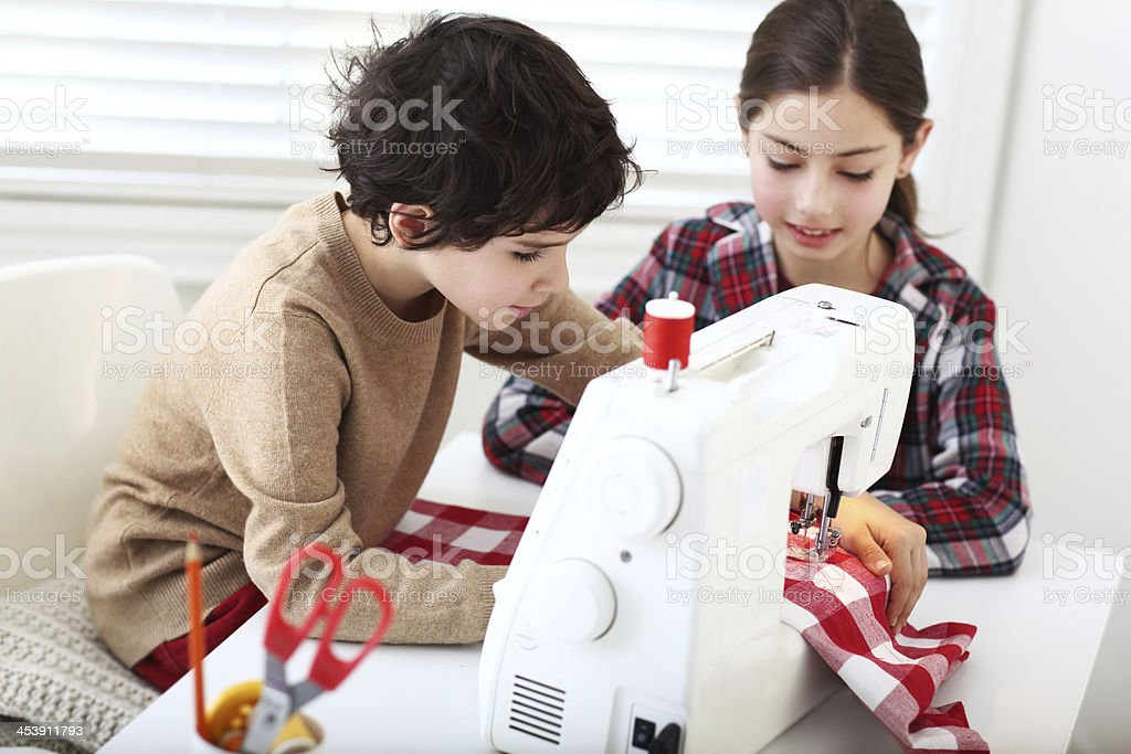 Sewing kids stock photo