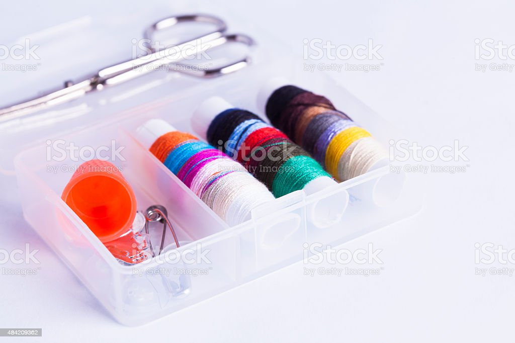Sewing kit on white background stock photo