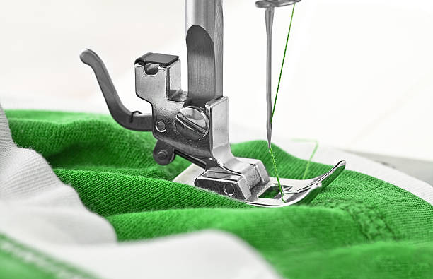 sewing machine and item of clothing - sewing machine needle stock photos and pictures