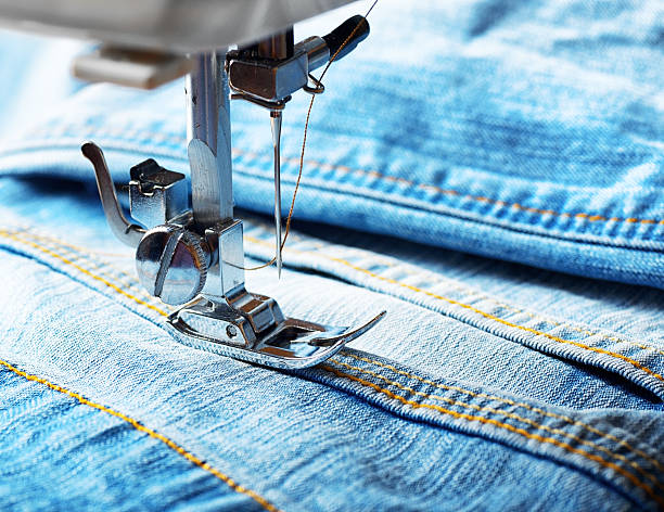 sewing machine and jeans fabric - sewing machine needle stock photos and pictures