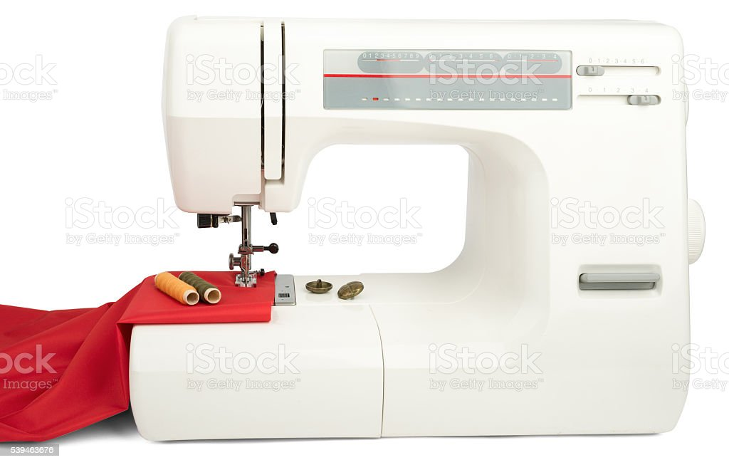 Sewing machine and red fabric isolated on white stock photo