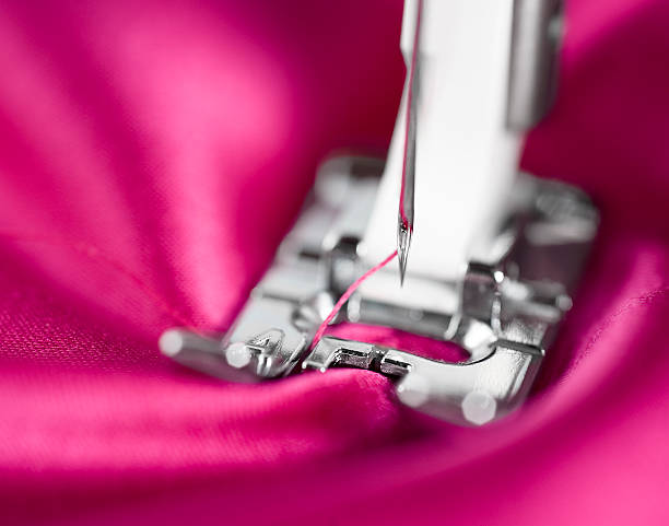 sewing machine foot with needle - sewing machine needle stock photos and pictures