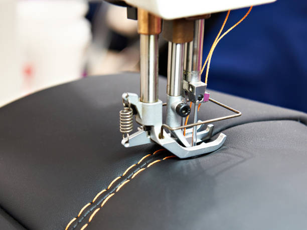 sewing machine for leather - sewing machine needle stock photos and pictures