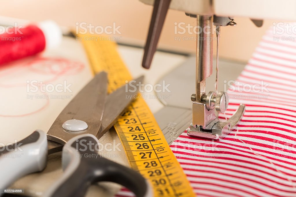 Sewing machine. Hobby sewing fabric as a small business concept stock photo