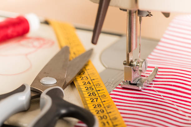 sewing machine. hobby sewing fabric as a small business concept - seam stock photos and pictures