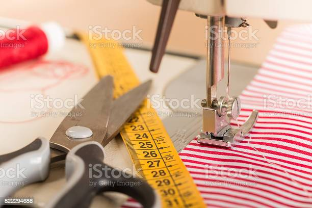 Sewing machine. Dressmaker work on the sewing machine.Tailor making a garment in workplace.Hobby sewing fabric as a small business concept