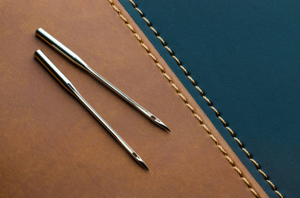sewing machine needles for leather - seam stock photos and pictures