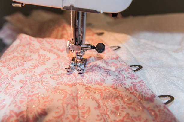 sewing machine on pink patterned fabric stock photo