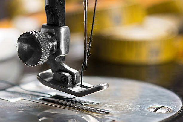 sewing machine - sewing machine needle stock photos and pictures
